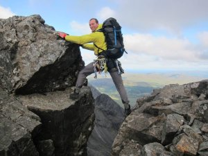 David from the Skye Cuillin ridge bridging a gully