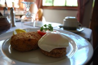 Smoked Haddock & Salmon Fishcake with Poached Egg and Grilled Tomato Breakfast at Gowan Brae B&B Fort William